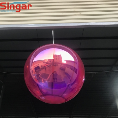 Inflatable pink hanging mirror ball